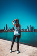 Fit woman standing against cityscape of Chicago