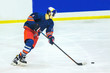 ice hockey player with puck on the ice