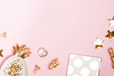 Golden decor and feminine accessories on the pink background, - 228106174