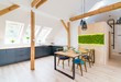 Wooden set table and modern kitchen in the attic