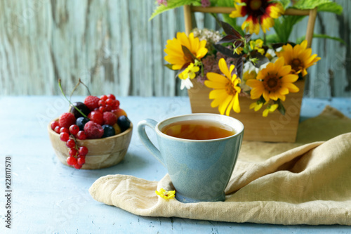Foto Murales bouquet of wildflowers on a wooden background, rustic still life