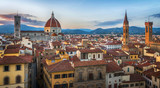 Panoramic view of Florence sunset city skyline with Cathedral and bell tower Duomo and Palazzo del Bargello. Florence, Italy.