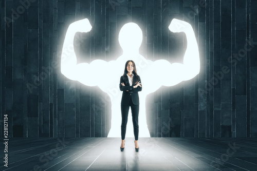 Leinwanddruck Bild Businesswoman with muscly arms