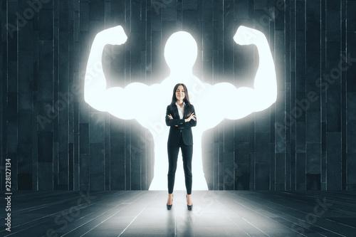 Leinwandbild Motiv Businesswoman with muscly arms