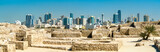 Ruins of Bahrain Fort with skyline of Manama. A UNESCO World Heritage Site - 228133150