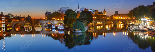 Panoramic view of Ile de la Cite and Pont Neuf at sunrise in Paris, France, as seen from Pont des Arts - 228133395