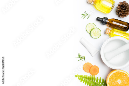 Foto Murales scrubs with natural ingredients rosemary orange cucumber and leaves on white