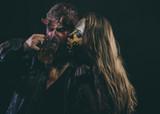 Halloween couple, woman man drink beer on black background - 228137751