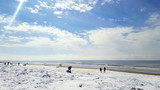 Fresh snow on golden beach.