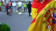 Leinwanddruck Bild - Female covered with Spanish flag standing in street, country patriot at rally