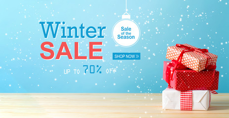 Winter sale message with Christmas gift boxes with red ribbons