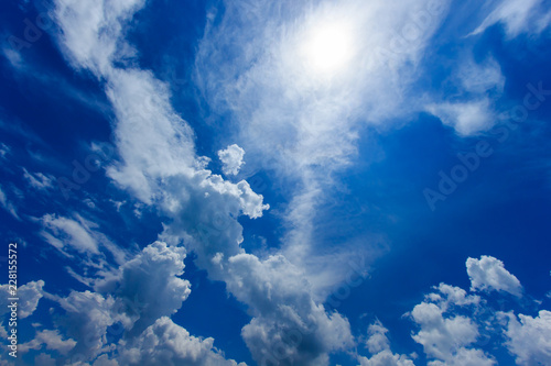 Dark blue sky with white clouds. - 228155572