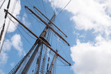 mast and rigging of an historic  sailing ship against the blue sky with clouds, adventure voyage concept, copy space - 228158390