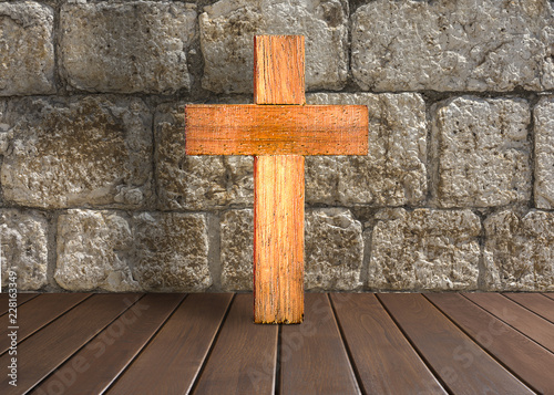 Antique wooden cross on stone background
