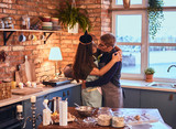 Handsome male kiss his wife in loft style kitchen at morning. - 228172797