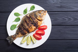 Fried fish dorado with lime , tomatoes and spinach - 228176596