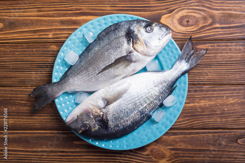 Leinwandbild Motiv Raw dorado fish in plate with ice