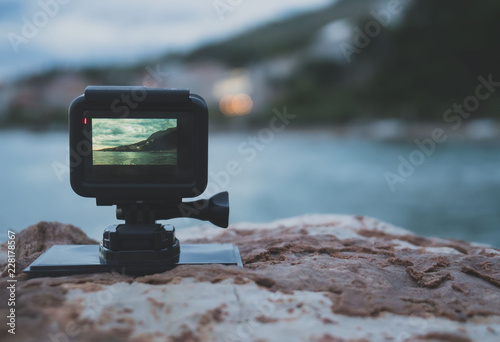 Small action camera shooting time-lapse on sunset. - 228178567