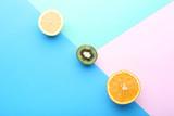 Ripe lemon, kiwi and orange on colorful background - 228180397