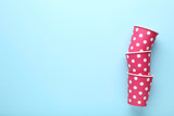 Pink paper cups on blue background - 228181774