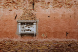 Sculpture of the Lion of Venice on red wall in Venice, Italy