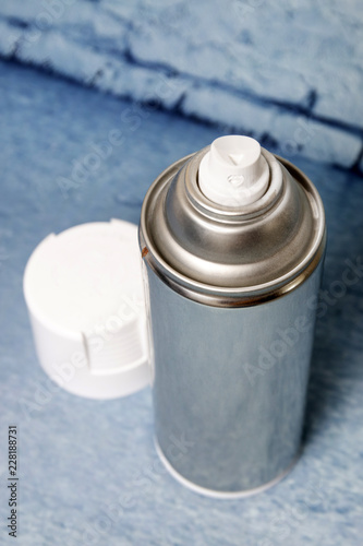 Spray can on a blue background - 228188731