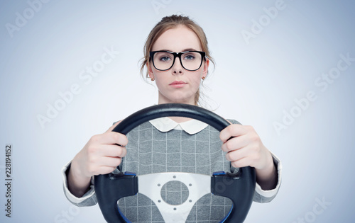Fridge magnet Young girl in glasses with steering wheel, auto concept