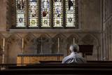 A man praying in a church