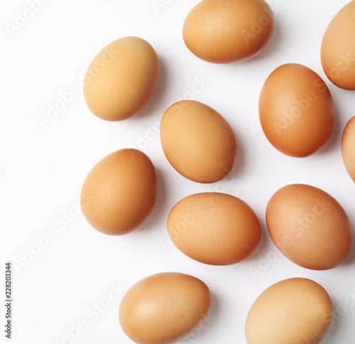 Leinwandbild Motiv Raw chicken eggs on white background, top view