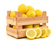 Quadro fresh lemons in a wooden box on a white background