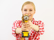 Woman aiming with drill