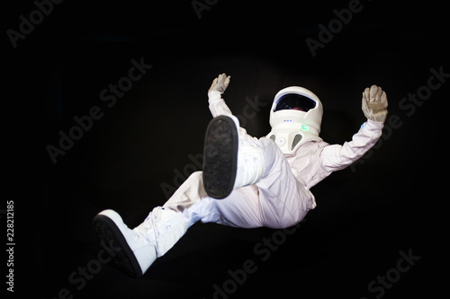 Astronaut in space, in zero gravity on black background. - 228212185