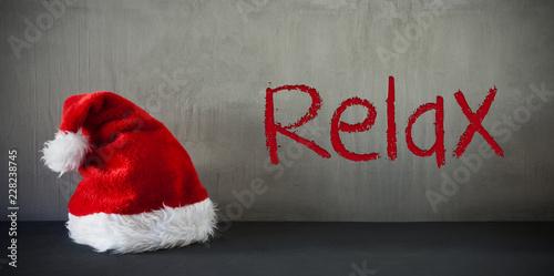 Leinwandbild Motiv Santa Hat, Text Relax, Gray Cement Background