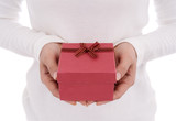 woman holding gift box in a gesture of giving isolated on white background
