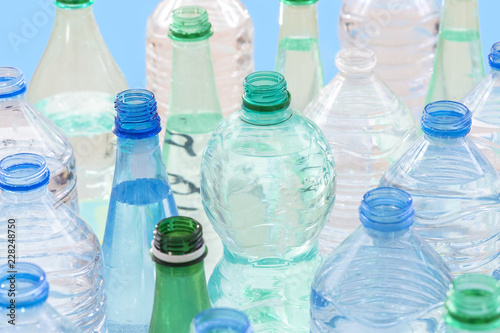 Leinwanddruck Bild plastic bottle recycling concept. collection of various plastic bottles on white background.