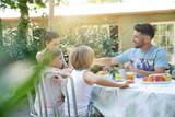 Family having breakfast in summer morning - 228253340