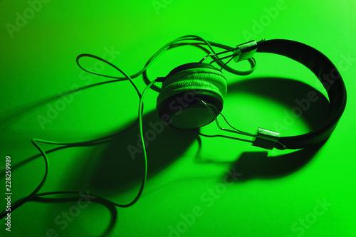 Leinwandbild Motiv Modern headphones on bright color background