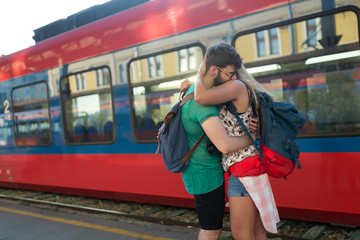 Beautiful couple parting at train station