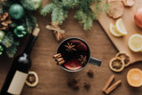 top view of cup of homemade mulled wine with cinnamon sticks on wooden tabletop, christmas concept - 228262740