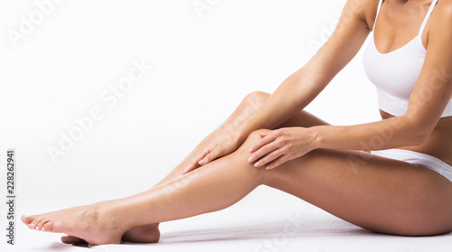 Woman touching own legs
