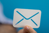 email in mans hand