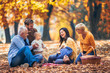 Quadro Multl generation family in autumn park having fun