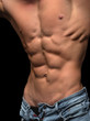 Muscular and sexy shirtless man with perfect abs and chest.
