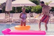 Quadro Family games. Happy positive girl having fun while playing with her father in the pool