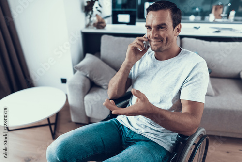 Leinwanddruck Bild Disabled Person in Wheelchair Talking Phone