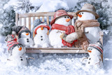 Postcard with Christmas and a new year with  cute snowmen - 228311926