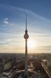 Leinwanddruck Bild - Fernsehturm in Berlin abends im Gegenlicht