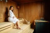 Beautiful woman in finnish sauna - 228319179