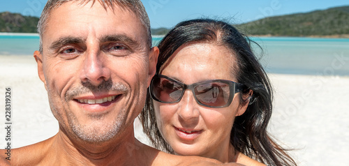 Happy couple in the 40s during a ocean holiday. Travel concept