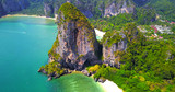 Isolated Tropical Islands With Lush Greenery Surrounded by Turquoise Ocean Water with Boats Moored Off Coast - Aerial Overhead View - Thailand - 228328169